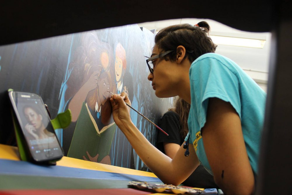 Student working on her painting