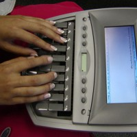 Photo of a person using a stenographer's recorder