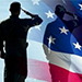 Photo of two soldiers saluting the American flag