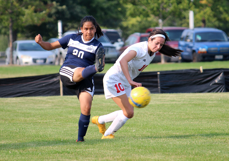 Photo of 2015 Women Soccer player kicking the ball.