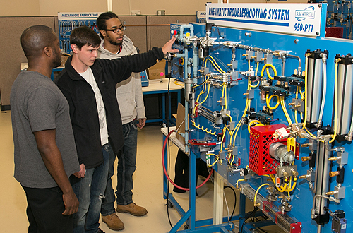 Manufacturing & Maintenance Technology students examining board
