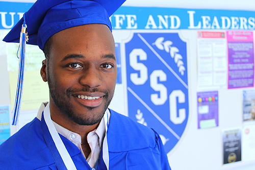 Photo of a black male graduate
