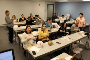 Pictured: SSC English as a Second Language Students make Mats for the Homeless