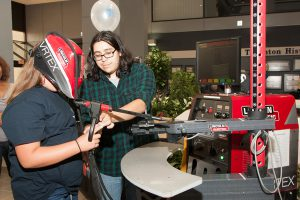 Open House visitor uses a virtual welding torch