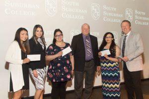 Illiana Financial Credit Union scholarship recipients Lilly Martlink, Ivonne Hernandez, and Elizabeth Cervantes pictured with Illiana representatives.