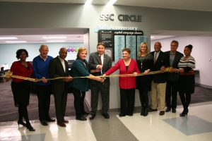 SSC's Robin Rihacek, Executive Director of Enrollment & Retention Services and Frank Zuccarelli cut the ribbon to officially open SSC Circle, a new student assistance facility.