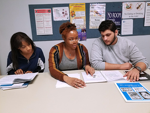 Tudors helping students in the AAC