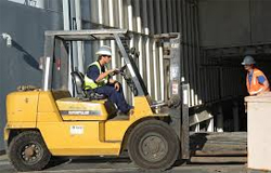 Photo of a man operating a forklift