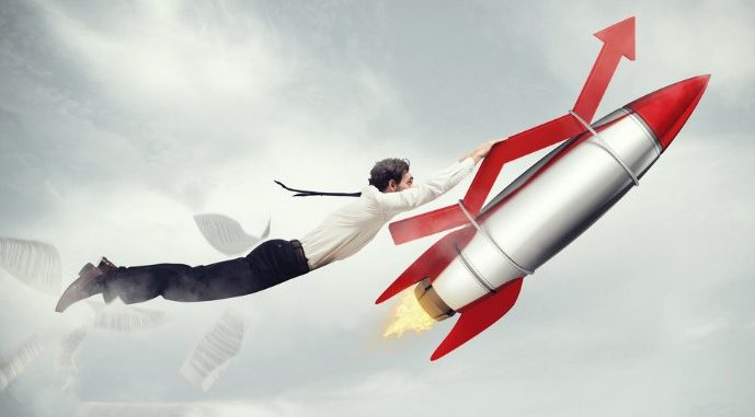 Photo of a business man hanging on a rocket
