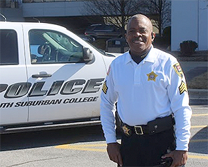 Photo of SSC police officer in front of a squad car