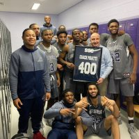 Bulldogs Head Coach John Pigatti and the 2020 Basketball Team celebrate his 400th win at South Suburban College.