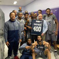 Bulldogs Head Coach John Pigatti and the 2020 Basketball Team celebrate his 400th win at South Suburban College.