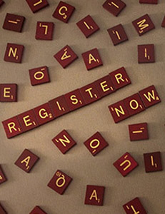 Scrabble tiles spells out REGISTER NOW