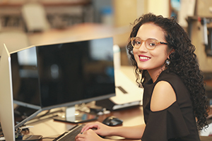 Photo of a woman at a computer