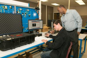 Photo of a Manufacturing instructor and student
