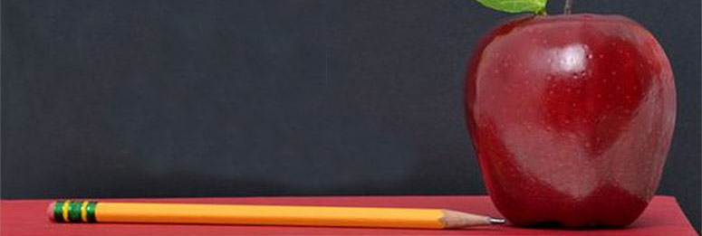 Photo of an apple and a pencil ona book