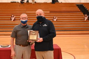 Photo of Bulldogs Head Coach John Pigatti is presented the 2021 Coach of the Year Award by Harry McGinnis, Triton College Athletic Director.