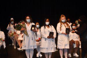Photo of South Suburban College Associate Degree Nursing graduates receive their pins.